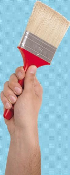 手握刷子免抠png透明图层素材